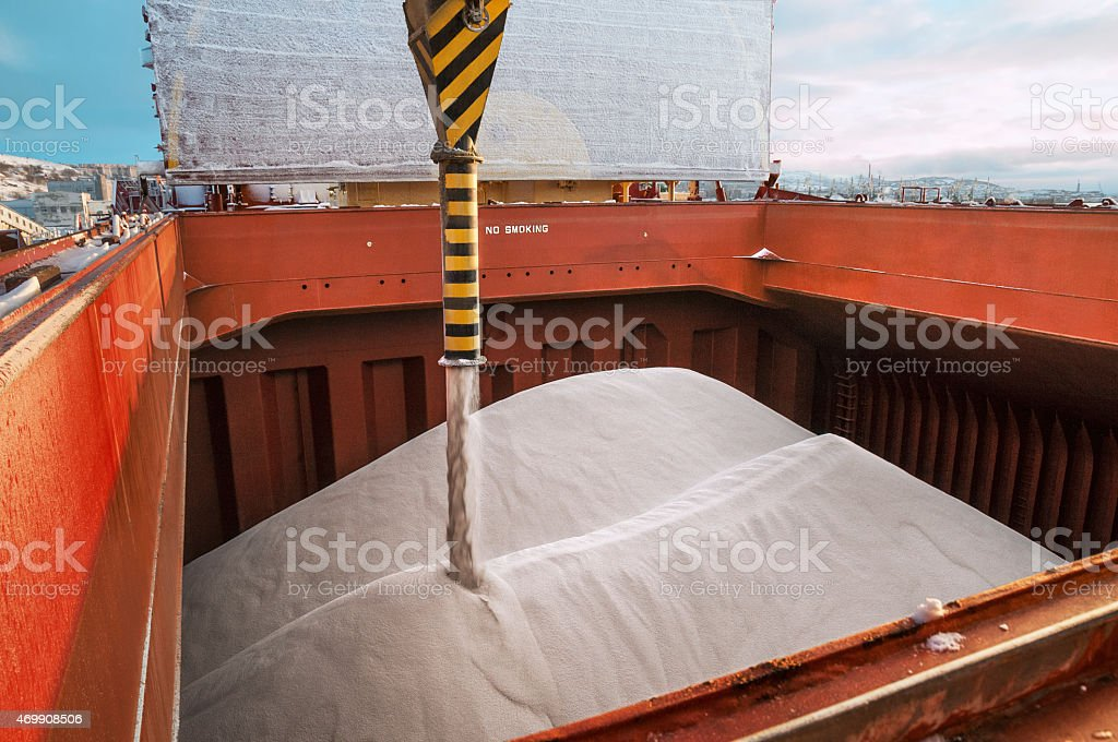 Loading fertilizer into the hold of bulker ship . stock photo