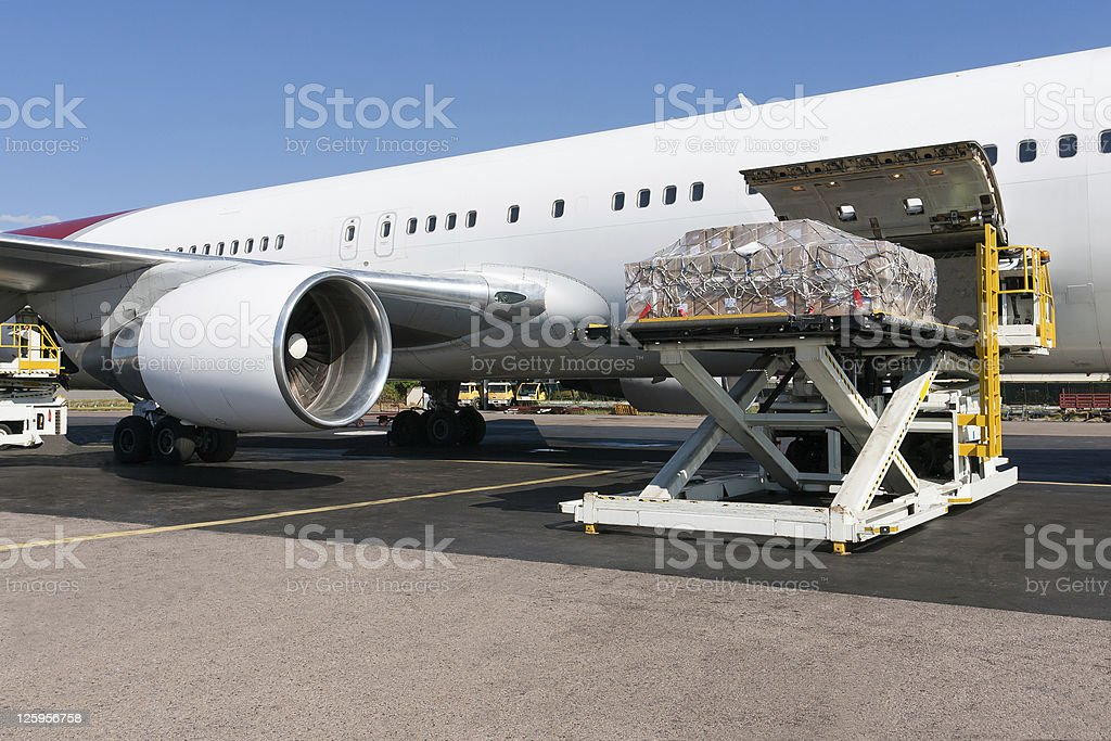 Loading freigth in airplane stock photo