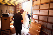 istock Loading furniture into removal truck 1193079766