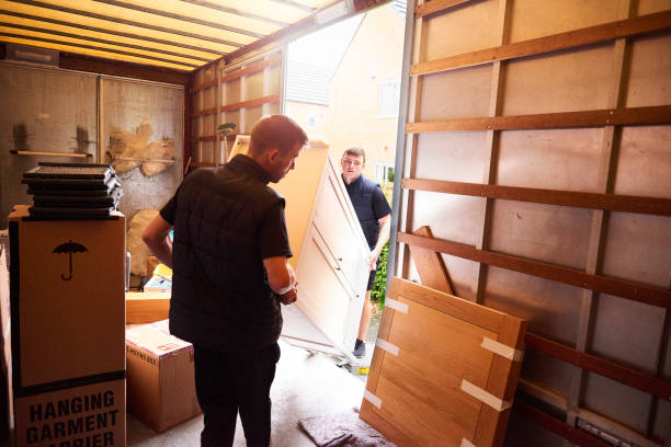 Loading furniture into removal truck Removal company helping a family move out of their old home physical activity stock pictures, royalty-free photos & images