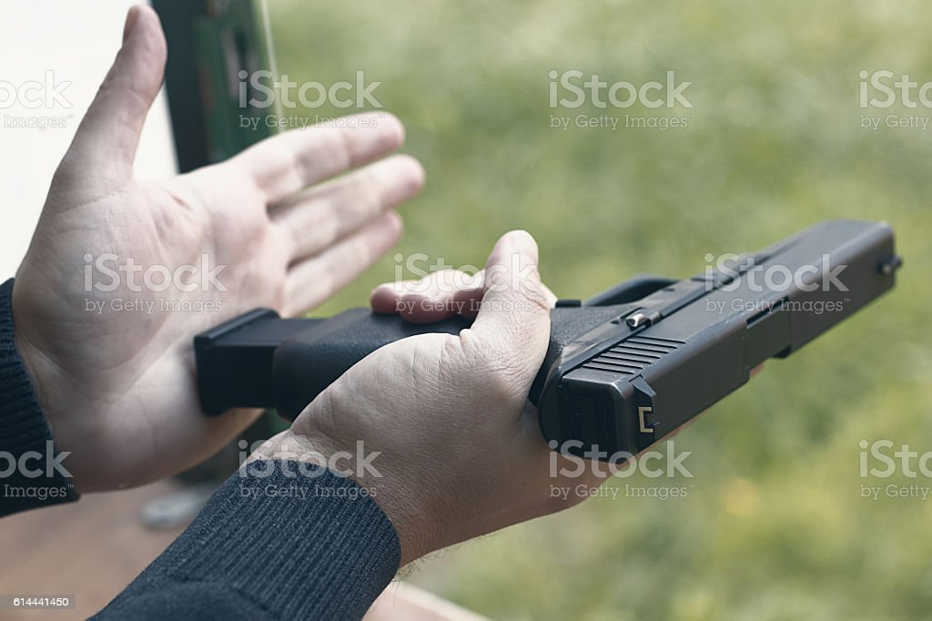 Loading Handgun. Reloading handgun. stock photo