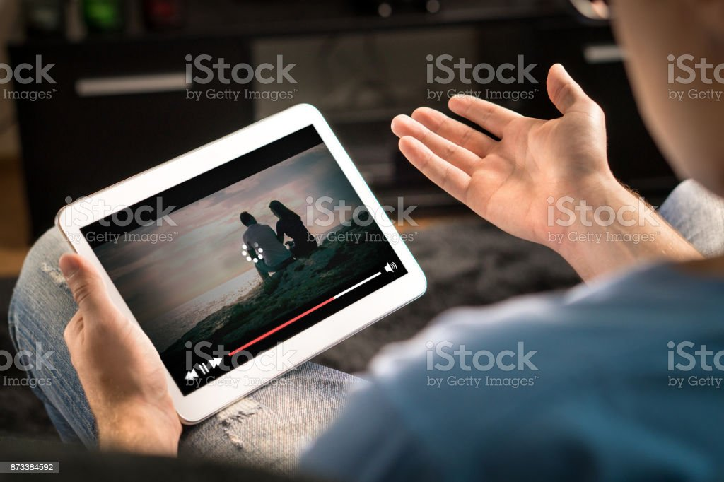 Loading icon rolling on video in an online movie streaming service. stock photo