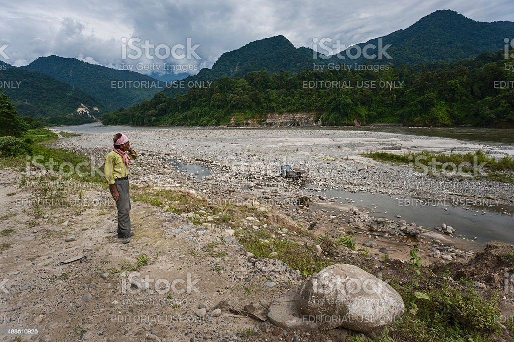 Loading lorry with stones for road construction, Arunachal Pradesh, India. stock photo