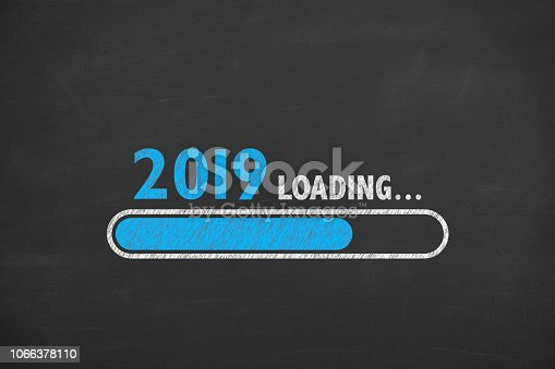 istock Loading New Year 2019 on Blackboard Background 1066378110