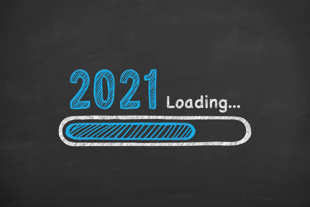 Loading New Year 2021 on Blackboard Background stock photo