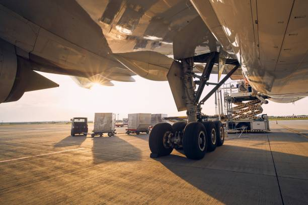 Loading of cargo containers to airplane stock photo