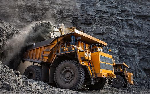 loading of coal in a quarry dumper front loader
