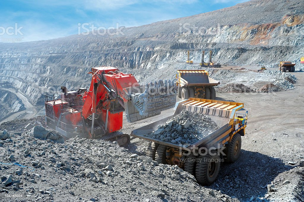 Loading of iron ore at iron site stock photo
