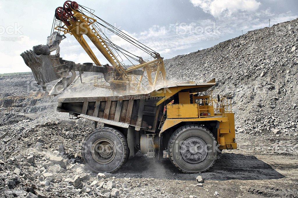 Loading of iron ore on truck stock photo