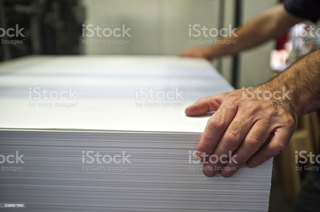 loading of paper operation stock photo
