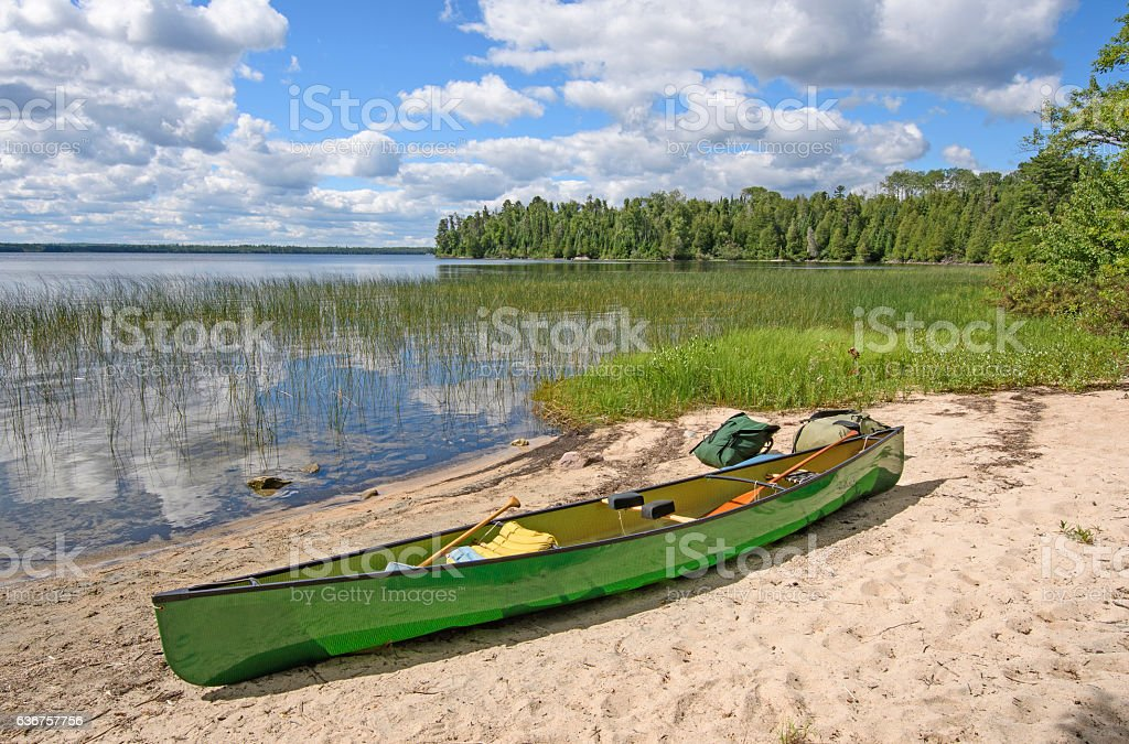 Loading the Canoe on Shore stock photo