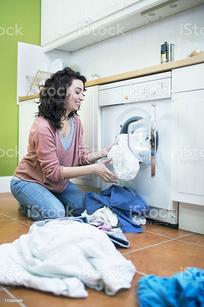 Loading the washing machine royalty-free stock photo