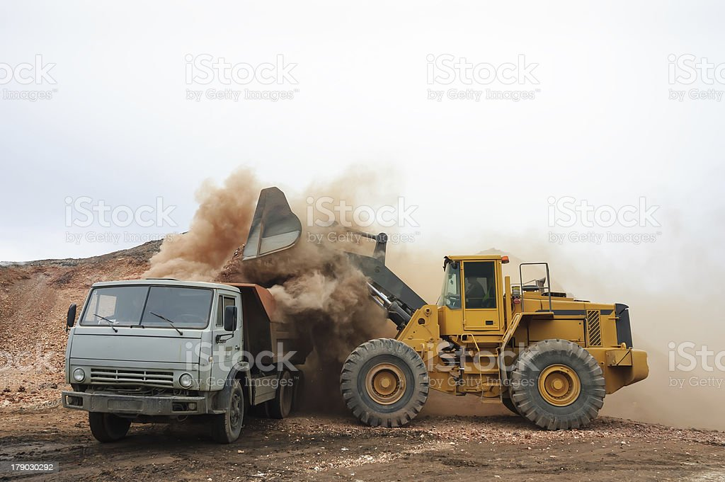 Loading truck with an excavator royalty-free stock photo