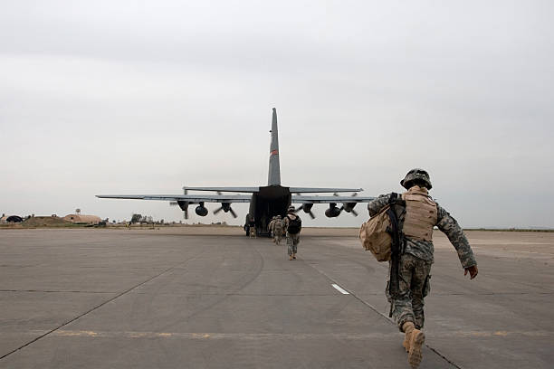 Loading up A soldier loads up onto an American plane near Mosul, Iraq. military airplane stock pictures, royalty-free photos & images