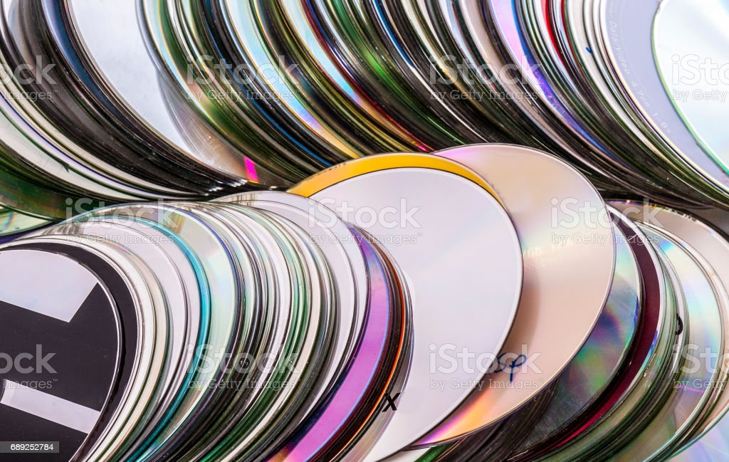 Loads of old used cd disks stock photo