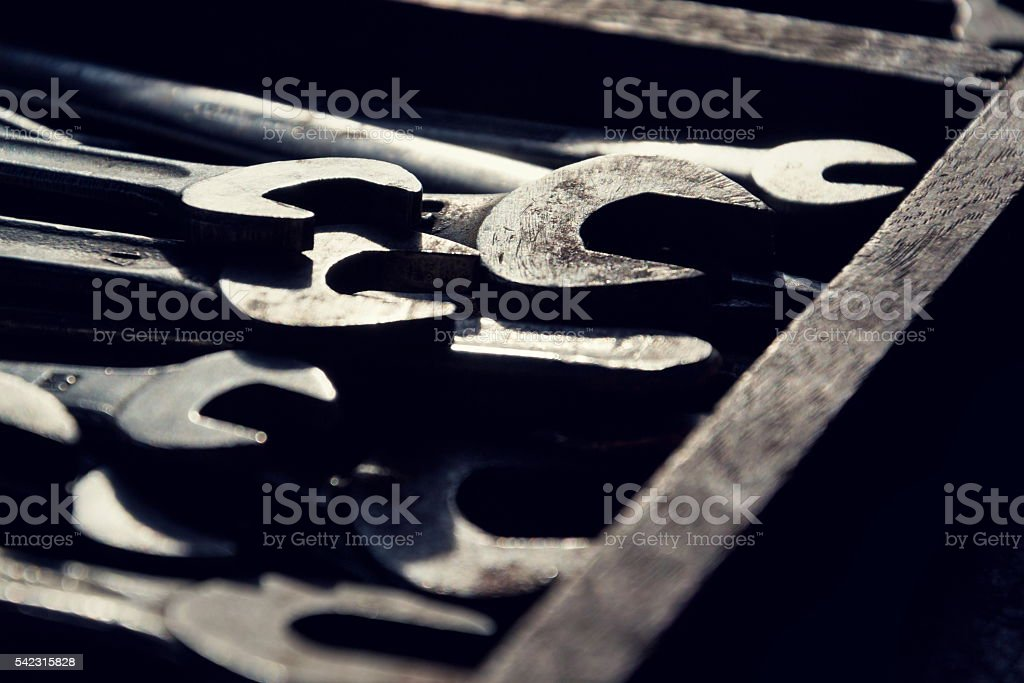 Loads of wrenches or spanners in a wooden drawer stock photo