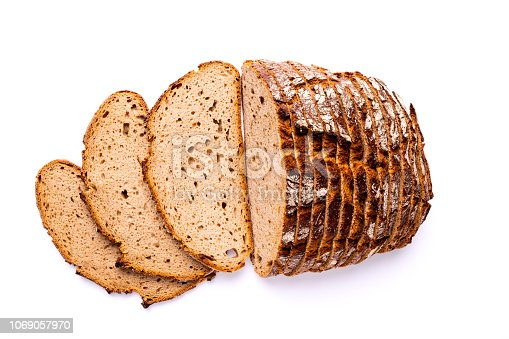 Loaf and slices of bread isolated on white background, view directly from above.