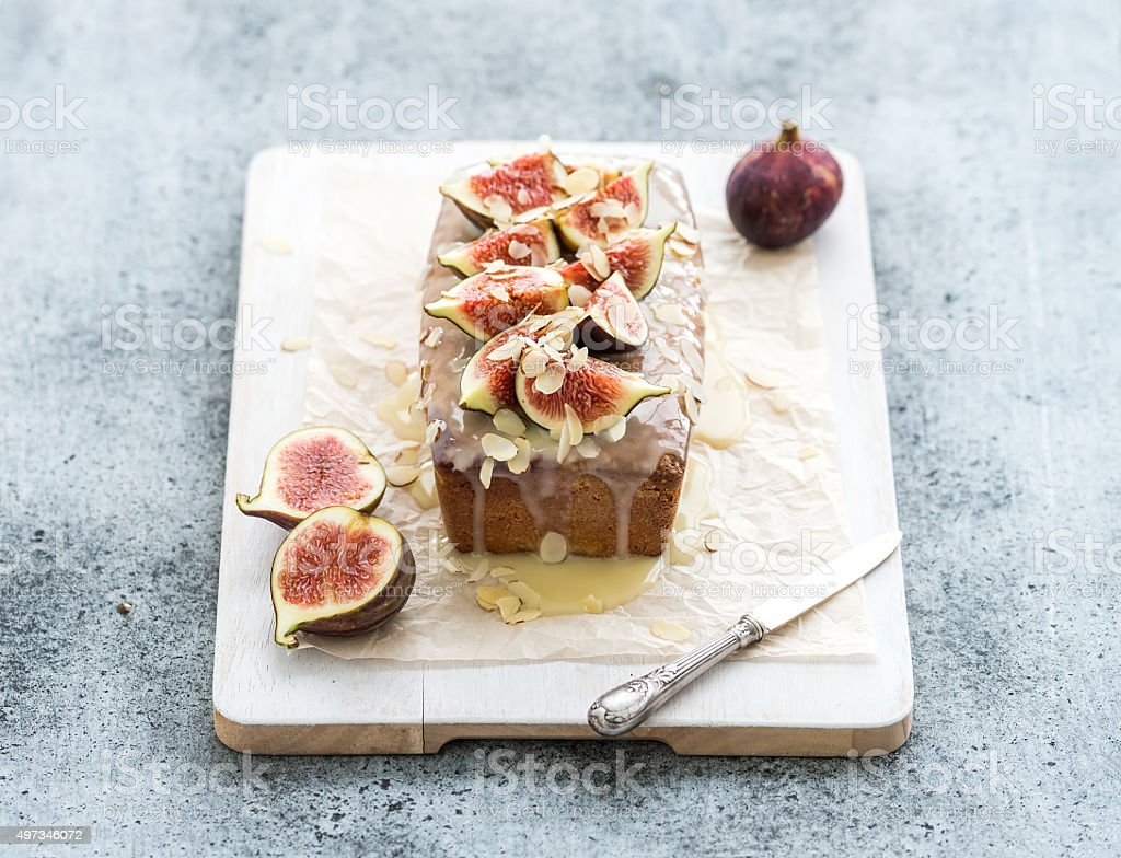 Loaf cake with figs, almond and white chocolate on wooden stock photo