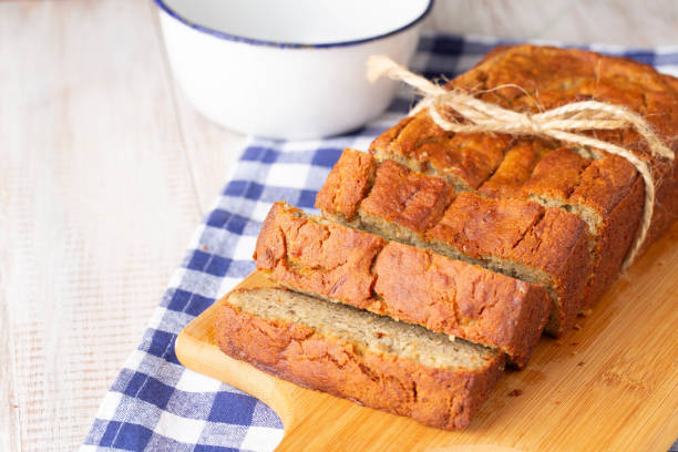 Loaf of Banana Bread With Bowl and Napkin stock photo