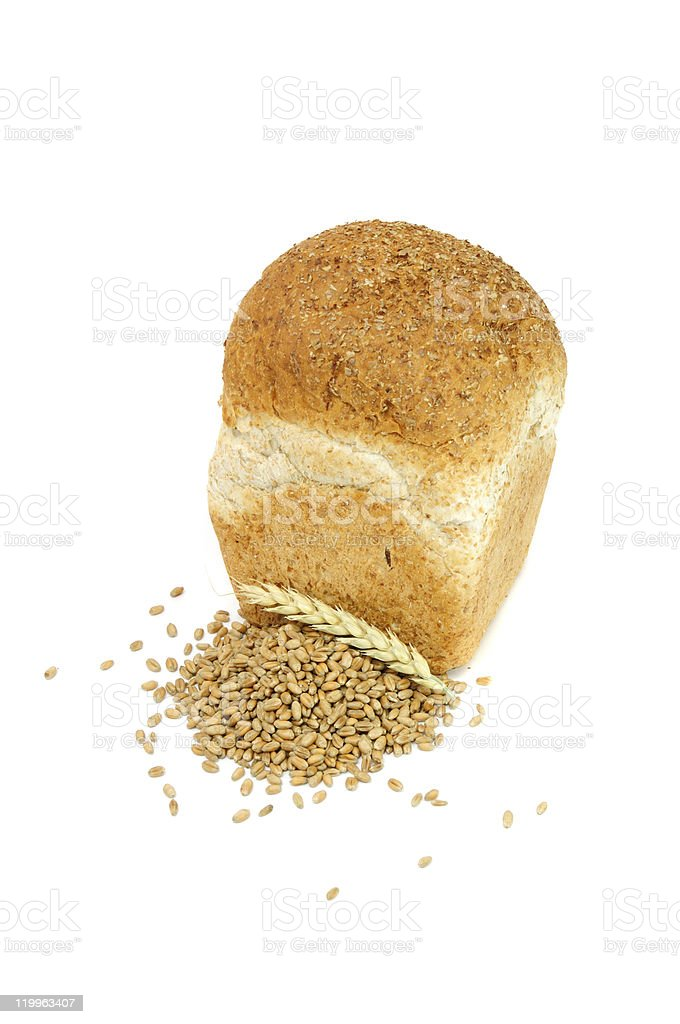 Loaf of Bran Bread with Wheat Grains And Ear royalty-free stock photo