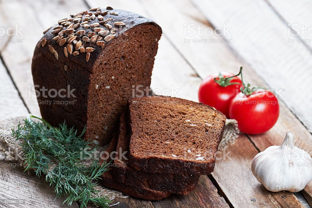 Loaf of bread and vegetables stock photo