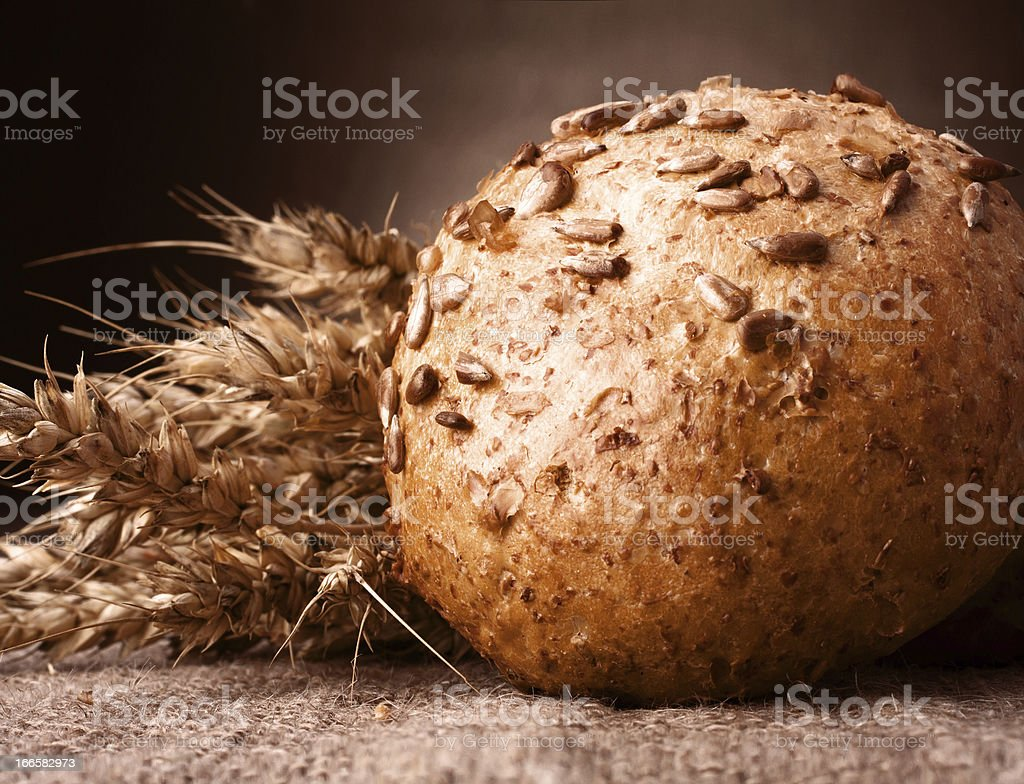 Loaf of bread and wheat ears still life royalty-free stock photo