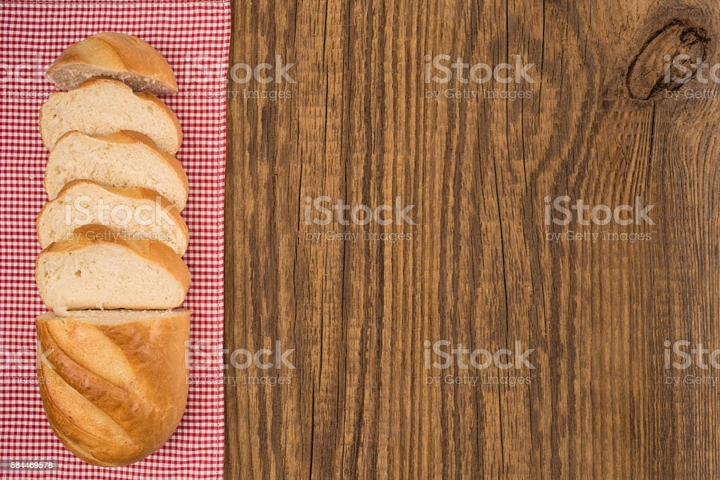 Loaf of bread on a wooden table. Top view stock photo
