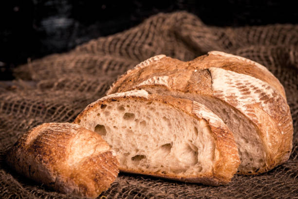 loaf of bread on burlap background, food closeup stock photo