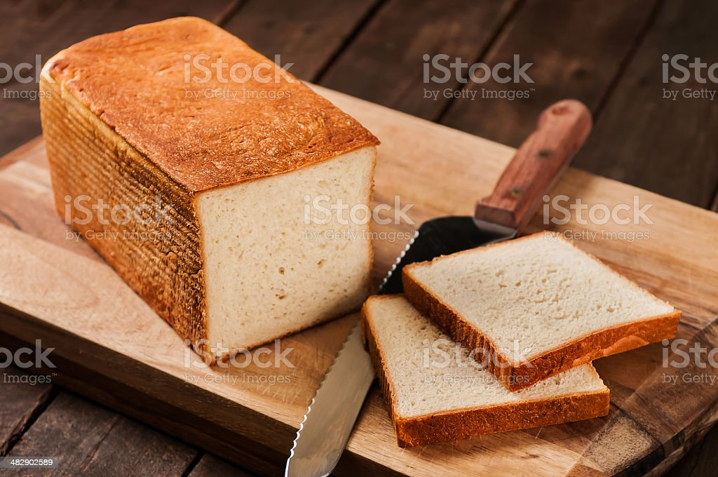 Loaf of Bread on Cutting Board royalty-free stock photo