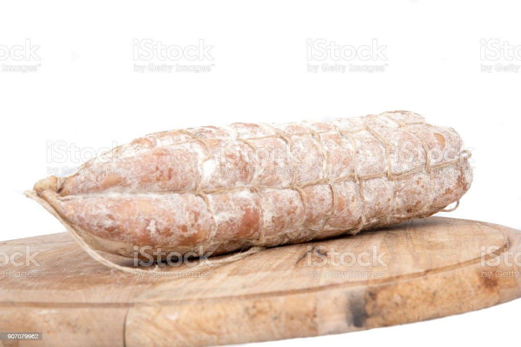 Loaf of bread with sausages on wooden plate stock photo