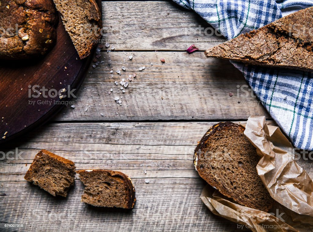 loaf of fresh rustic wholemeal rye bread on wooden board royalty-free stock photo