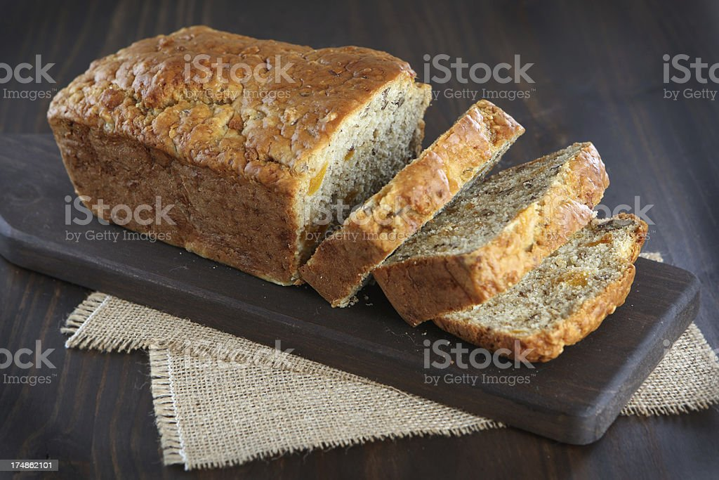 loaf of quick bread with apricots and nuts royalty-free stock photo