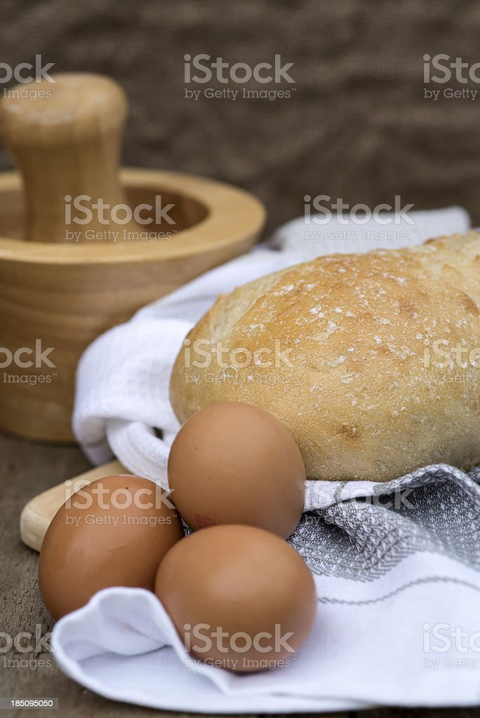 Loaf of sourdough bread in rustic kitchen setting royalty-free stock photo