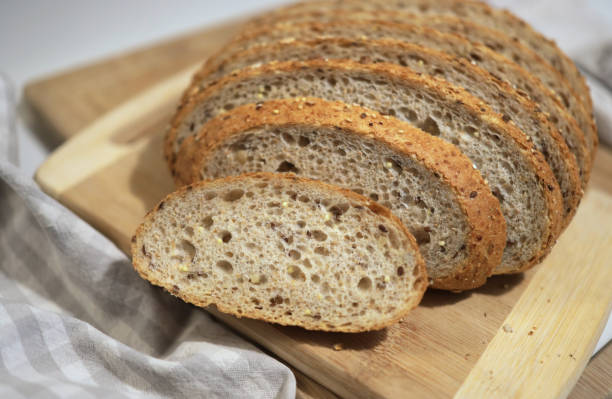 Loaf of Sourdough Multigrain Bread in a Kirchen stock photo