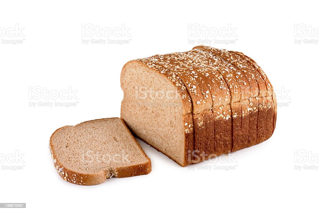 A loaf of wheat grain bread sliced royalty-free stock photo