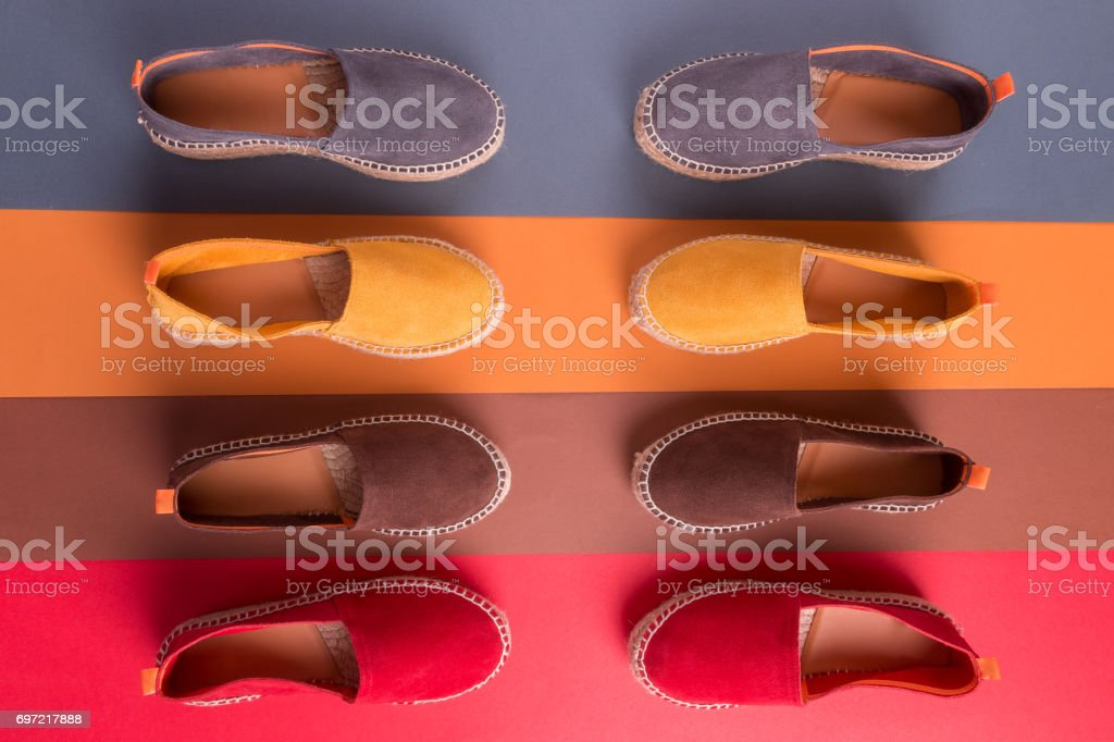 Loafers on multicolor background. Top view. Four pair. stock photo
