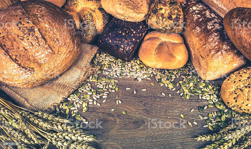 Loafs of bread and bread rolls stock photo