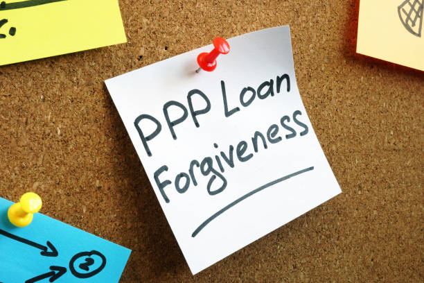 PPP loan forgiveness memo on the board. stock photo