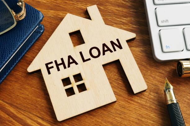 FHA loan written on the model of home. stock photo