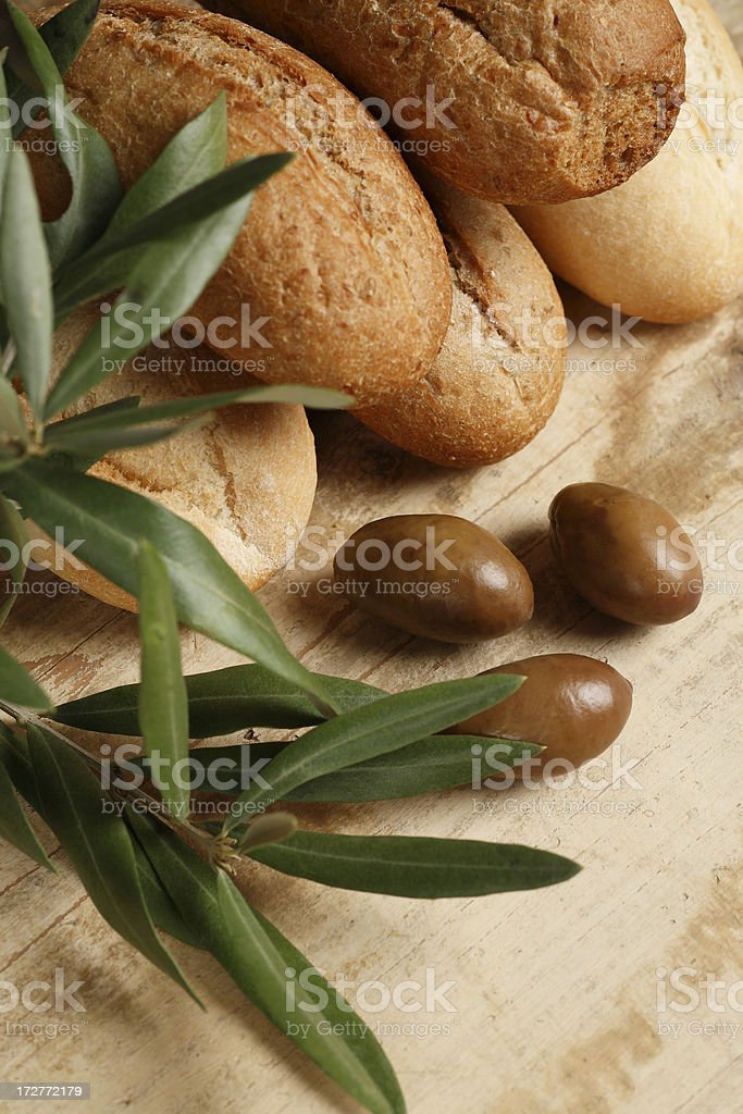 Loaves of bread and olives royalty-free stock photo