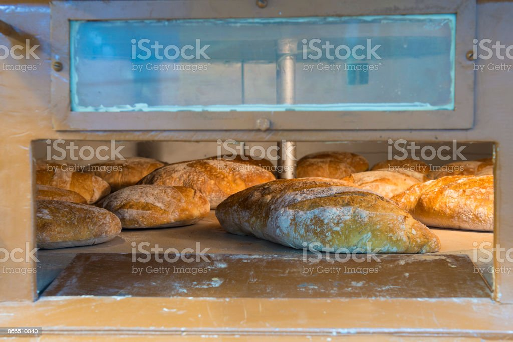 Loaves of bread inside a wood-burning oven stock photo