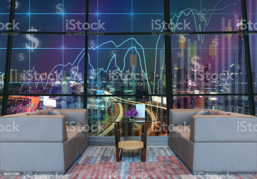 Lobby area of a hotel which can see Trading graph on the cityscape at night background,Business financial concept stock photo