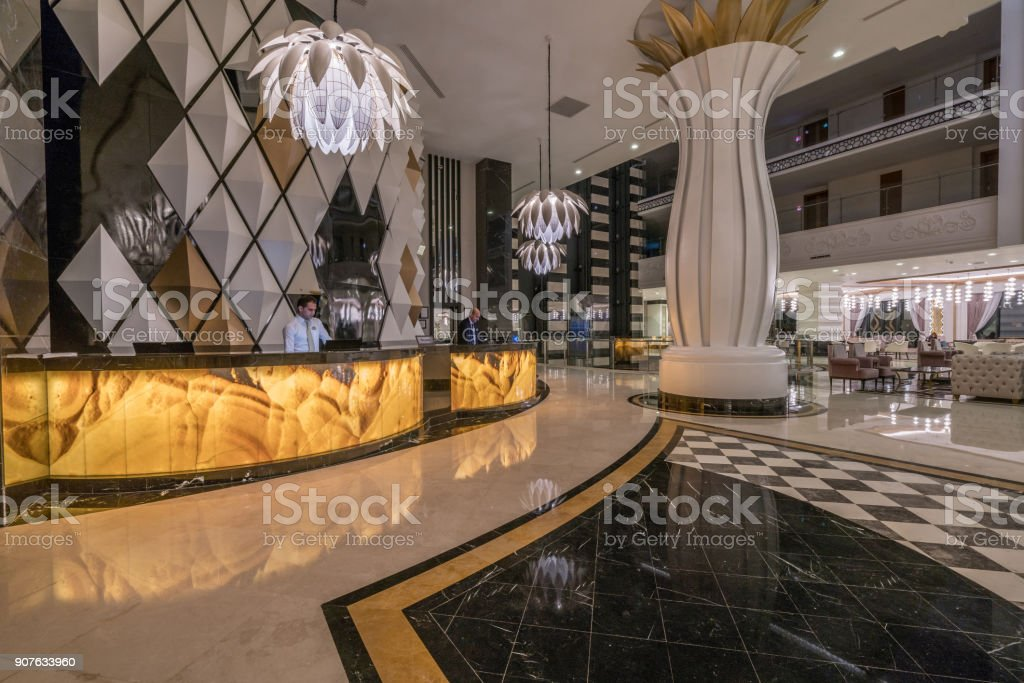 Lobby entrance with reception desk and lounge area stock photo