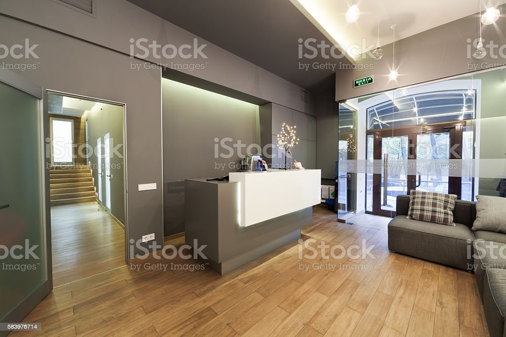 Lobby entrance with reception desk in a dental clinic. stock photo