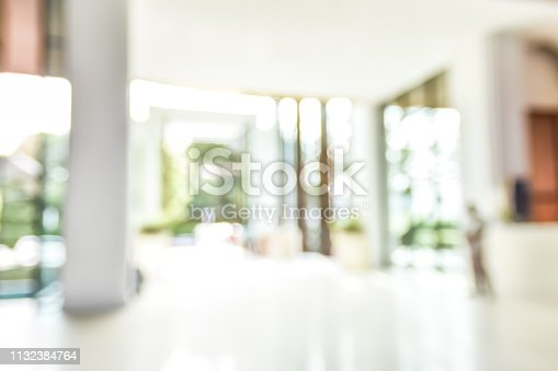 Lobby of resort hotel blur background luxurious entrance hall foyer interior view with reception desk counter, atrium space, entrance doors and glass wall