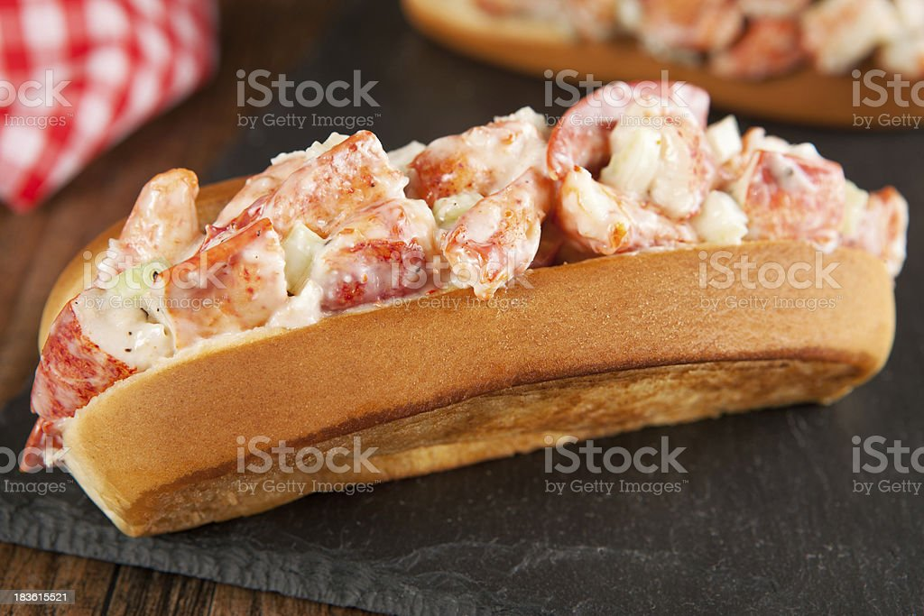 Lobster and sauce roll bap with tomatoes stock photo