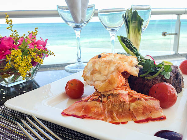 lobster and steak - caribbean food stock photos and pictures
