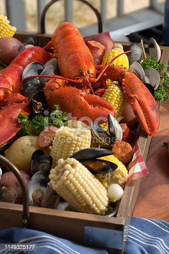 Lobster, corn and clams in a tray freshly baked