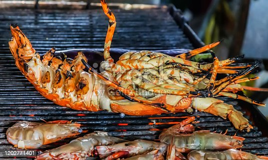 Lobster cooking flaming grill grid steamed Food Background