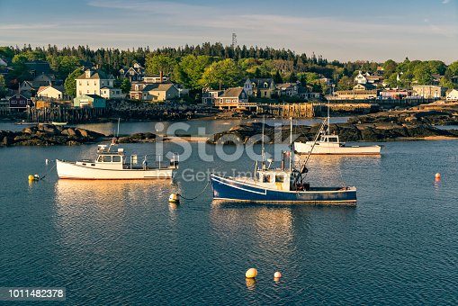Quiet scene at the end of the workday as the fishing boats are moored for the night in Stonington, Maine.